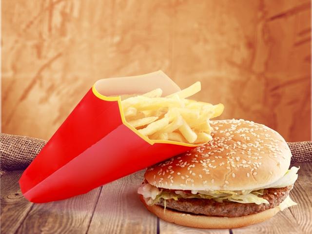 UK bans junk food ads in all children's media