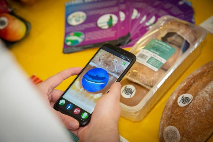 Scannable code offers augmented reality, reducing food packaging